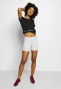 Calvin Klein Performance - CROPPED SHORT SLEEVE - Print T-shirt - black - 1