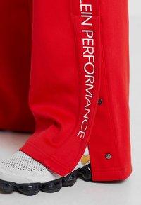 Calvin Klein Performance - PANTS - Teplákové kalhoty - high risk red - 5