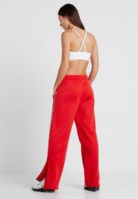 Calvin Klein Performance - PANTS - Teplákové kalhoty - high risk red - 2