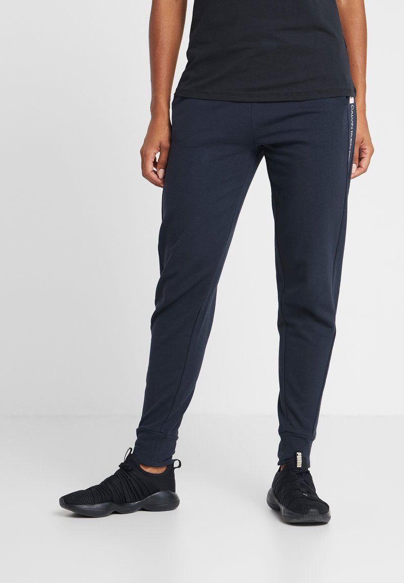 Calvin Klein Performance - PANTS - Verryttelyhousut - blue