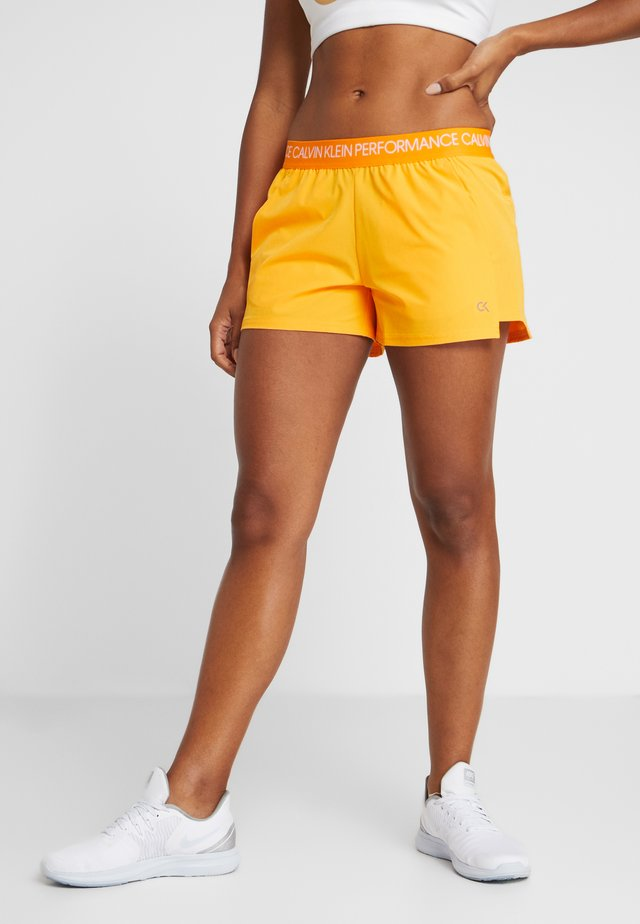 SHORTS - Urheilushortsit - orange
