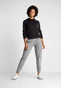 Calvin Klein Performance - PANTS - Tracksuit bottoms - grey - 1
