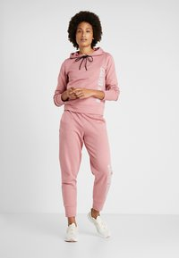 Calvin Klein Performance - PANTS - Tracksuit bottoms - pink - 1