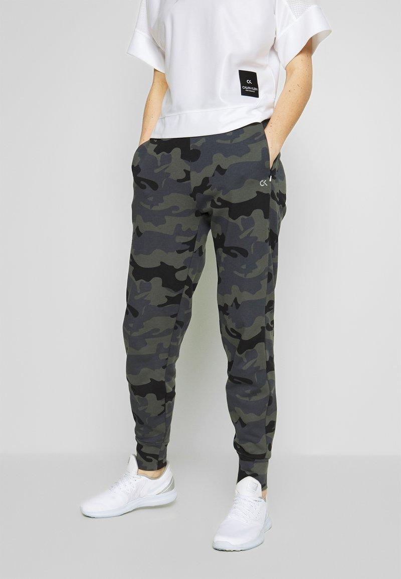 Calvin Klein Performance - PANTS - Tracksuit bottoms - black