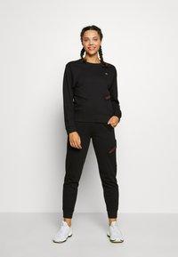 Calvin Klein Performance - PANTS - Tracksuit bottoms - black - 1