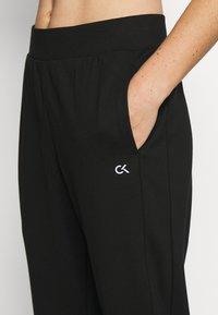 Calvin Klein Performance - Teplákové kalhoty - black - 4