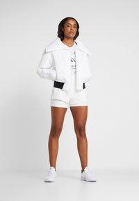 Calvin Klein Performance - LIGHT WEIGHT PADDED JACKET - Training jacket - white - 1