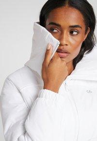 Calvin Klein Performance - LIGHT WEIGHT PADDED JACKET - Training jacket - white - 4