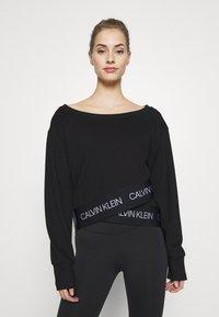 Calvin Klein Performance - Long sleeved top - black - 0