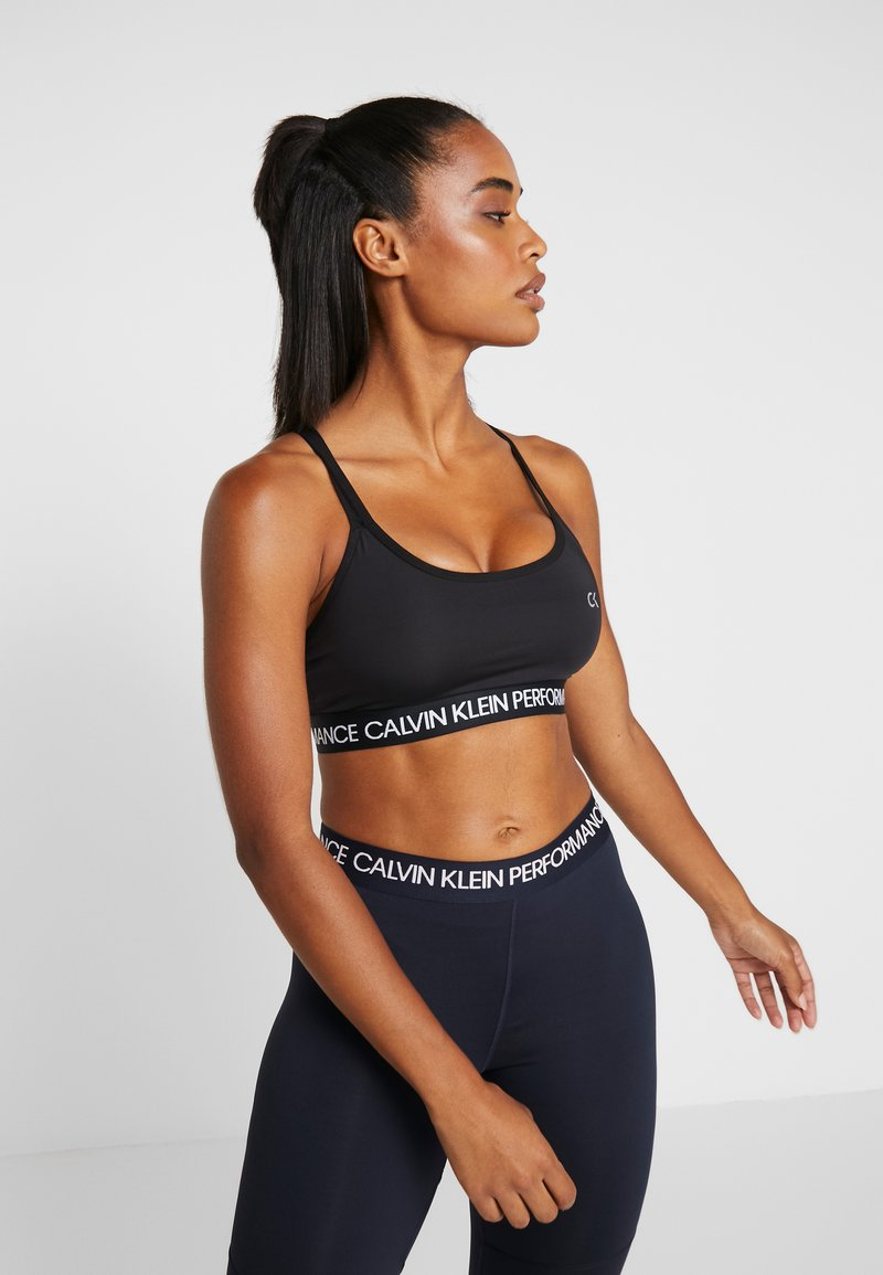 Calvin Klein Performance - LOW SUPPORT BRA - Sports bra - black