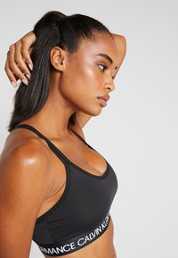 Calvin Klein Performance - LOW SUPPORT BRA - Sports bra - black - 3
