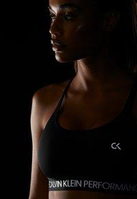 Calvin Klein Performance - LOW SUPPORT BRA - Reggiseno sportivo - black - 4