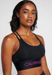 Calvin Klein Performance - LIGHT SUPPORT BRA - Reggiseno sportivo - black - 4