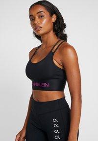 Calvin Klein Performance - LIGHT SUPPORT BRA - Reggiseno sportivo - black - 0