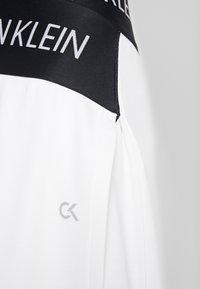 Calvin Klein Performance - ASYMMETRIC SKIRT - Sports skirt - white - 6