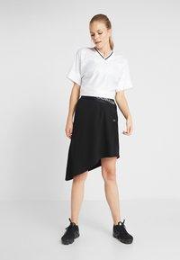 Calvin Klein Performance - ASYMMETRIC SKIRT - Jupe de sport - black - 1