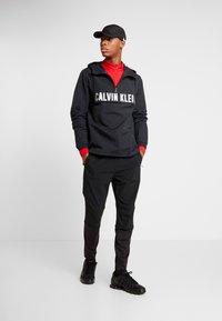 Calvin Klein Performance - ZIP LONG SLEEVE - Long sleeved top - red - 1