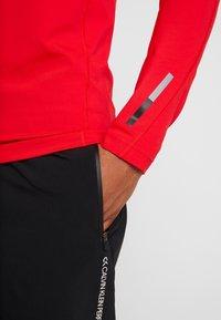 Calvin Klein Performance - ZIP LONG SLEEVE - Long sleeved top - red - 6