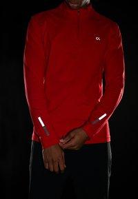 Calvin Klein Performance - ZIP LONG SLEEVE - Long sleeved top - red - 4