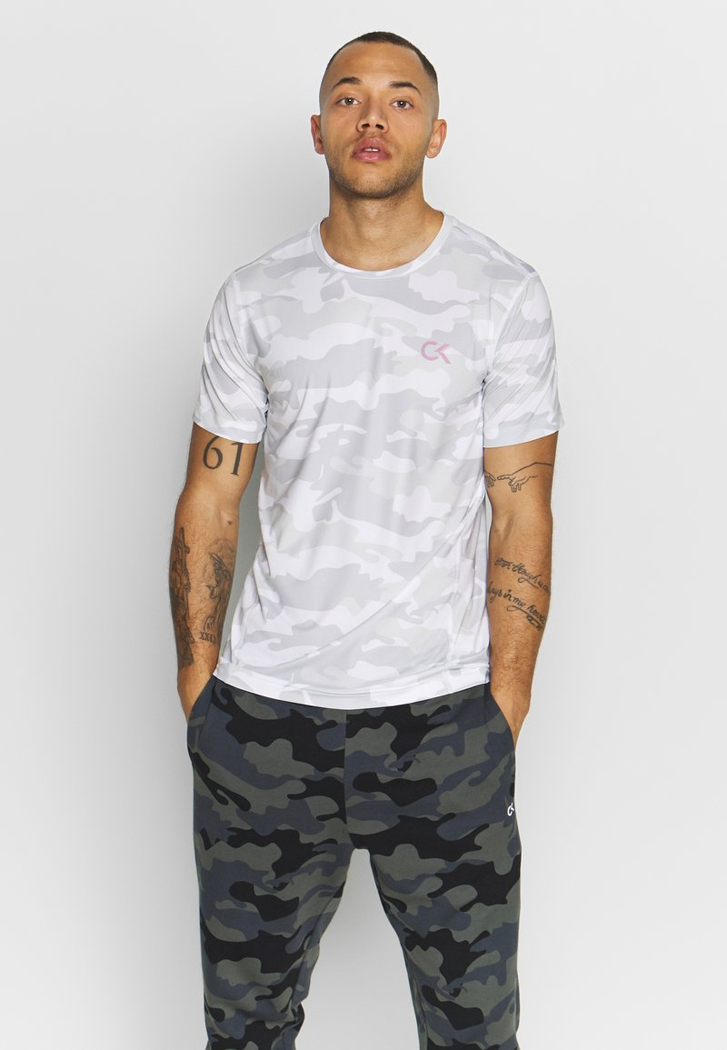 Calvin Klein Performance - PERFECT WORKOUT - Print T-shirt - white