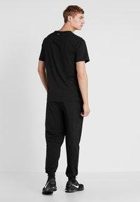 Calvin Klein Performance - PANTS - Tracksuit bottoms - black/bright white - 2