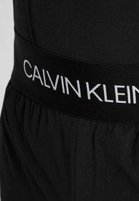 Calvin Klein Performance - PANTS - Tracksuit bottoms - black/bright white - 3