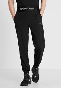 Calvin Klein Performance - PANTS - Tracksuit bottoms - black/bright white - 0