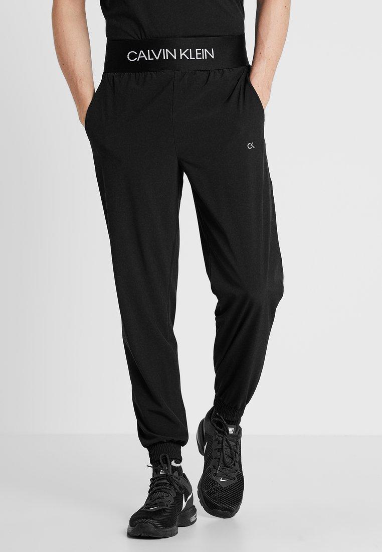 Calvin Klein Performance - PANTS - Tracksuit bottoms - black/bright white