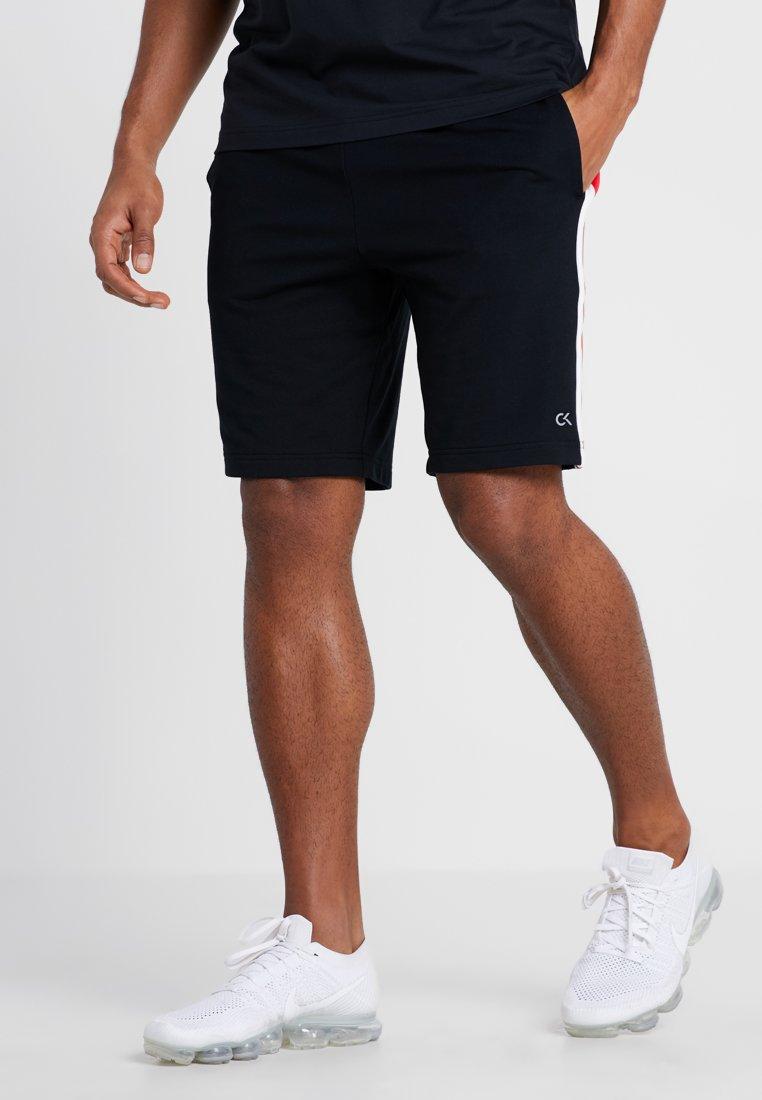 Calvin Klein Performance - SHORT - Korte sportsbukser - black/high risk red/coconut milk