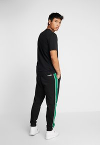 Calvin Klein Performance - PANTS - Tracksuit bottoms - black - 2