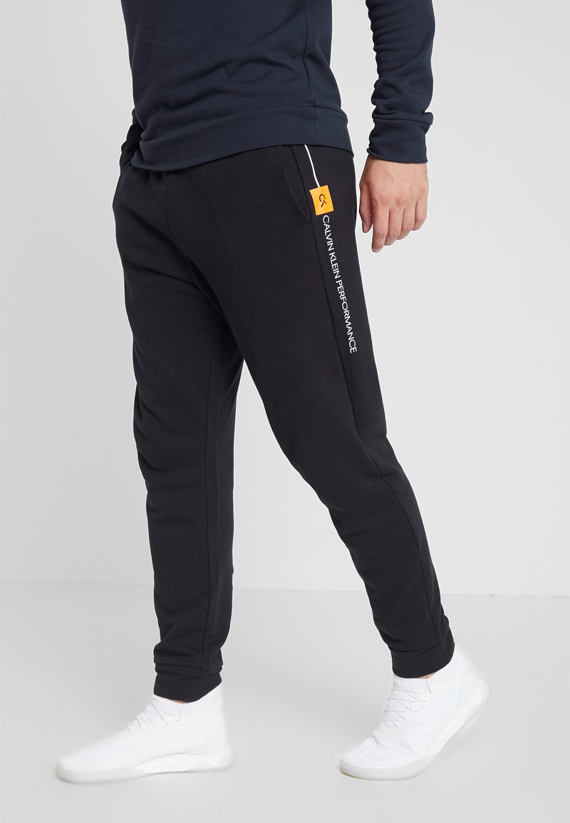 Calvin Klein Performance - PANTS - Verryttelyhousut - black