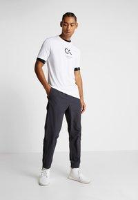 Calvin Klein Performance - TRACK PANTS - Trainingsbroek - gunmetal/black - 1