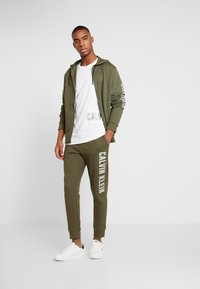 Calvin Klein Performance - PANTS - Tracksuit bottoms - green - 1