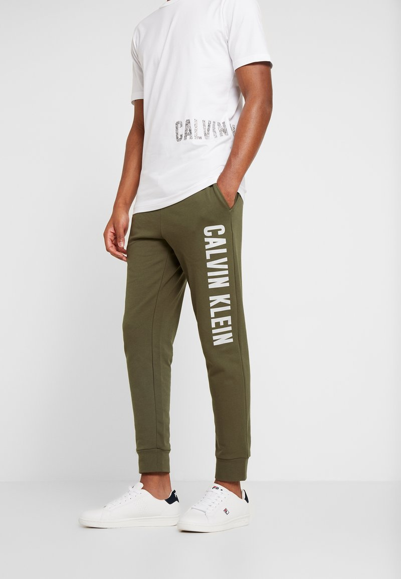 Calvin Klein Performance - PANTS - Tracksuit bottoms - green