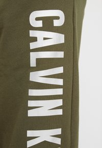 Calvin Klein Performance - PANTS - Tracksuit bottoms - green - 5