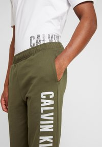 Calvin Klein Performance - PANTS - Tracksuit bottoms - green - 3