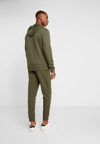 Calvin Klein Performance - PANTS - Tracksuit bottoms - green - 2