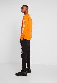Calvin Klein Performance - PANTS - Trainingsbroek - black - 2