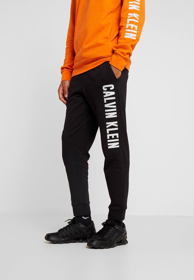 PANTS - Verryttelyhousut - black