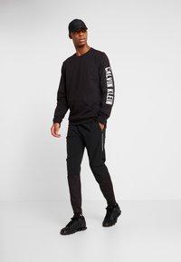 Calvin Klein Performance - TECH PANT - Spodnie treningowe - black - 1