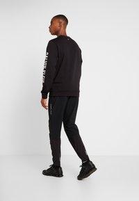 Calvin Klein Performance - TECH PANT - Spodnie treningowe - black - 2