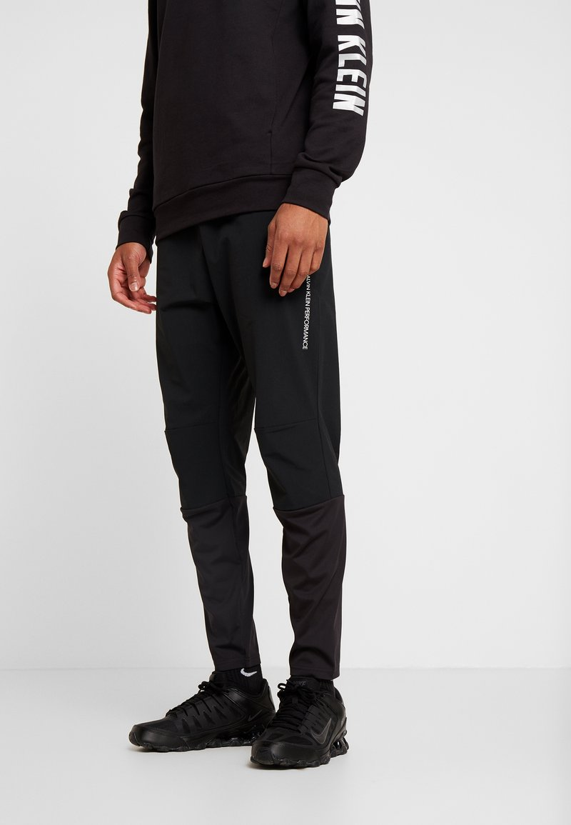 Calvin Klein Performance - TECH PANT - Spodnie treningowe - black