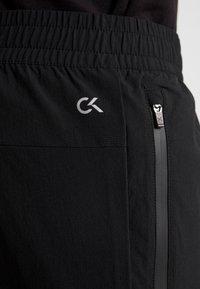 Calvin Klein Performance - TECH PANT - Spodnie treningowe - black - 5