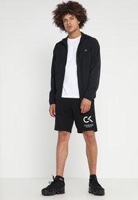 Calvin Klein Performance - JACKET - Veste coupe-vent - black - 1