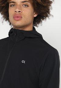 Calvin Klein Performance - JACKET - Veste coupe-vent - black - 5