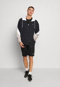 Calvin Klein Performance - HOODED JACKET - Verryttelytakki - black - 1