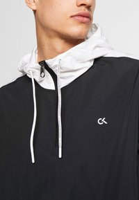 Calvin Klein Performance - HOODED JACKET - Verryttelytakki - black - 5