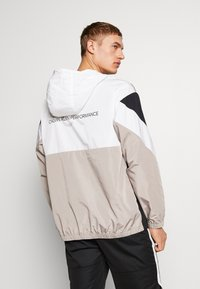 Calvin Klein Performance - HOODED JACKET - Verryttelytakki - black - 2