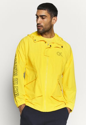 HOODED JACKET - Sadetakki - yellow