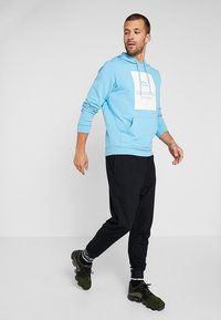 Calvin Klein Performance - HOODY - Hoodie - ethereal blue/bright white - 1